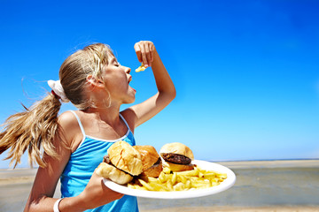 Child eating fast food.