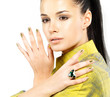 woman with golden nails and precious stone emerald