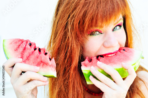 girl enjoying   watermelon