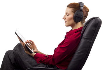 Woman listening to audio books on a tablet