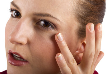 woman applying anti aging cream ointments