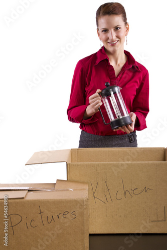 woman packing stuff in moving boxes