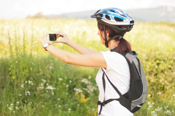 Cyclist taking picture with smartphone