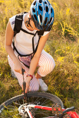 Cyclists tire pump on the mountain