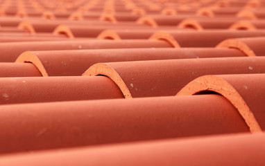 Red tile roof closeup photo with selective focus