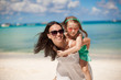 Young beautiful mother and her adorable little daughter have fun