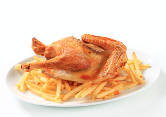 Crispy roast chicken with French fries