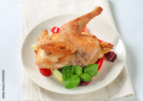 Roast chicken with vegetable garnish