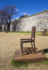 Metal chair in the center of the ancient capital