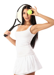 Young woman posing with tennis racket and ball over white