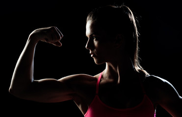 woman athlete showing biceps