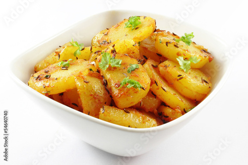 fried potatoes on a white background - Bratkartoffel auf weißem