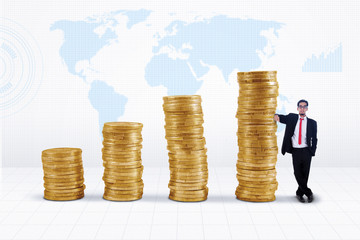 Businessman and gold coins growth chart