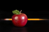 Pencil through red apple.