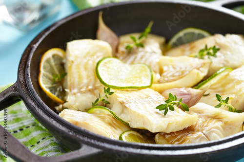 Baked fish fillet with lime and garlic