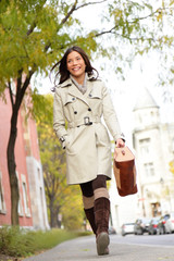 Young stylish female professional holding handbag