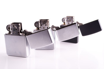 Silver metal zippo lighters on white