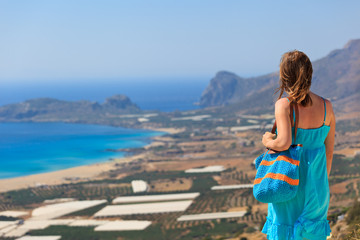 woman looking over beach on Crete