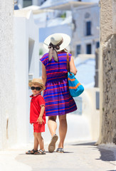 mother and son walking in Santorini, Greece