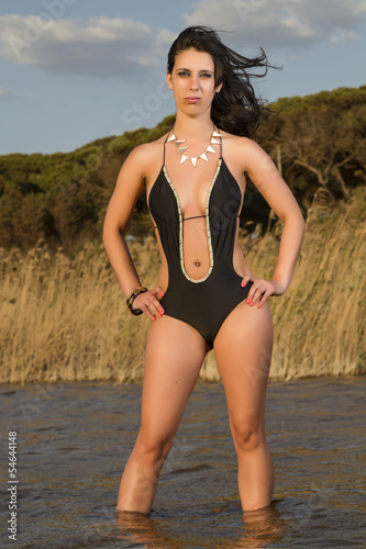 beautiful young woman in a black trikini