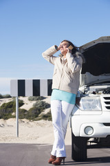 Woman stressed with car breakdown