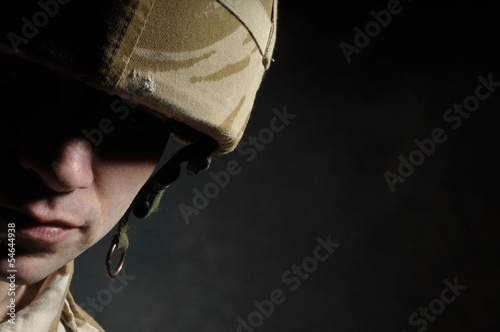 Portrait Of Soldier In Deep Shadow Suffering With PTSD