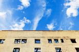 blue sky above furbished house poster