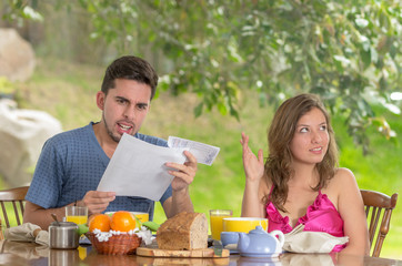 Stressed man and woman arguing about family budget