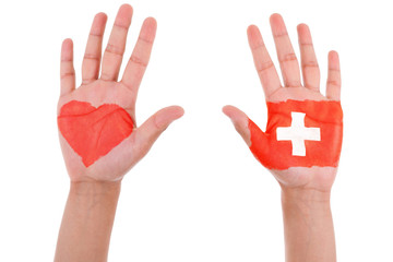 Hands with a painted heart and swiss flag, i love switzerland co