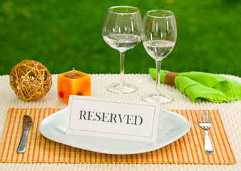 Reserved sign in dinner plate