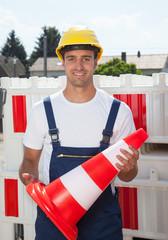 Bauarbeiter sorgt für Sicherheit