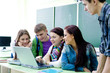 group of students studying with laptop