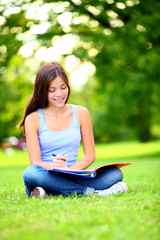 Student girl studying in park