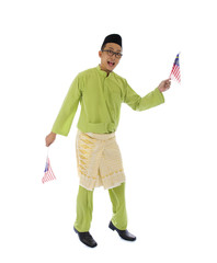 malay male jumping with malaysian flags wearning traditional clo
