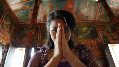 Asian girl praying in temple, wat, pagoda, Phnom Penh, Cambodia