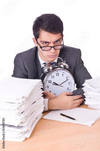 Woman businessman with giant alarm clock