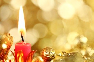 Candle and defocused abstract background