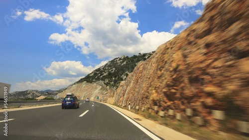 Driving a car over a mountain highway through tunnels Time lapse