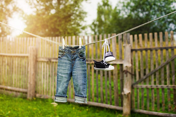 children's jeans and sneakers on the clothesline