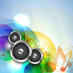Glossy speakers with musical notes on abstract background.