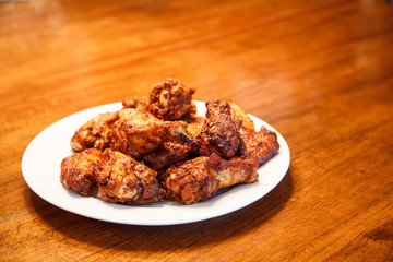 Mesquite Barbecued Wings on Wood Table