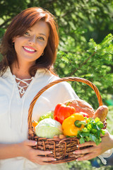 Woman holding basket of vegetables