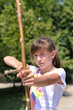 Young girl practising her archery