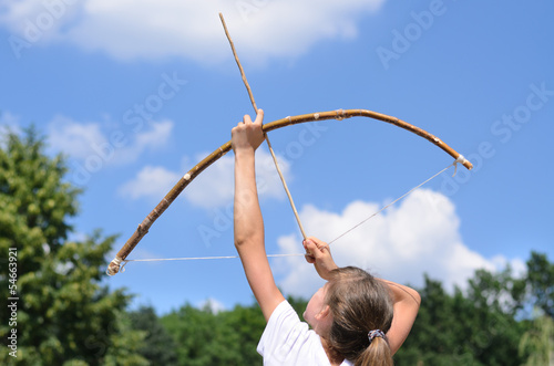 Young girl practising archery
