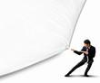 Businessman pulling blank banner