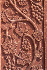 Mural sculpture of grape vines in red sandstone at Fatehpur Sik