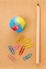 School supplies with Globe, clip and notebook  on white backgrou