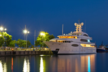 Yacht in the port at night