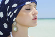 beautiful woman in a blue shawl on the beach. arabic style