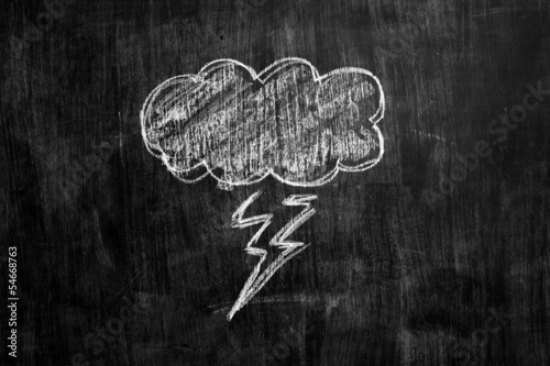 Chalk drawing of thundercloud on blacboard